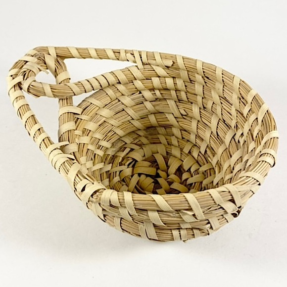 Vintage coiled basket with handle
